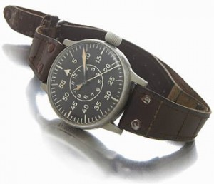 A.Lang & Sohne, Germany. A fine and unusual massive brushed steel hacking center seconds military aviators wristwatch. 1940s.
