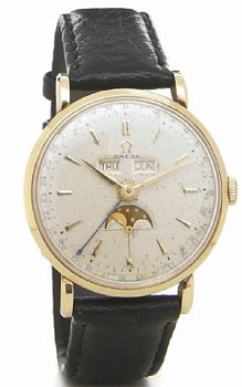 Omega. A 14k gold triple-calendar wristwatch with moon phases. 1947.
