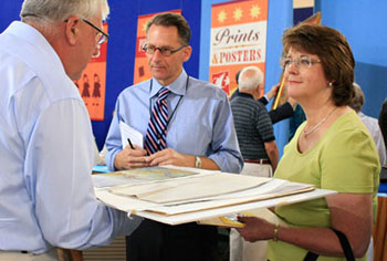 David Weiss (center) of Freeman's Auctioneers is an expert on paintings, prints, sculpture, and Oriental rugs. He attended Antiques Roadshow in San Jose as a Prints & Posters appraiser.