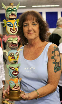 A guest shows us her ceramic totem pole while waiting for an appraiser. Although only one side is pictured, the totem features unique and colorful faces on both sides.