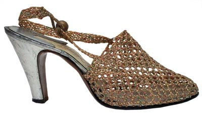 Italian designer Ferragamo is one of the most famous names in shoes. This cellophane and kid shoe is from 1938.
