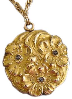 Lockets were also in demand during the Art Nouveau period. This gold-filled example has embossed flowers and rhinestones.