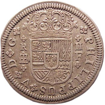 Top: The Obverse of a 1723 Pistareen, minted in Segovia Spain. Pistareens and all Spanish silver coinage played an important part in the U.S. colonial economy. Above: The reverse of a 1723 Pistareen.