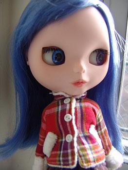 Blythe in a sherpa lined winter jacket.