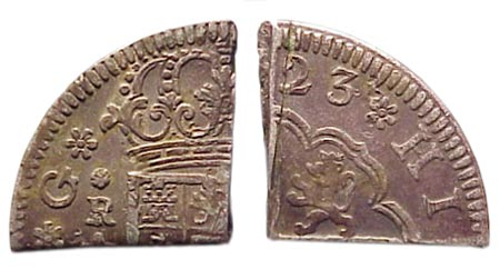 The 1723 Pistareen, minted in Segovia Spain chopped to make quarters.