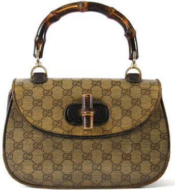 A Gucci Brown Logo Print Bag, 1960s, in a plastic coated GG logo fabric, with bamboo handle and closure, GG logo at front, fully lined. Stamped: Gucci. Property from a Distinguished Park Avenue Private Collection, New York, New York.