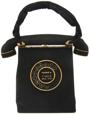 The dial on this 'Telephone' Bag from the 1960s features the name and phone number of its owner.