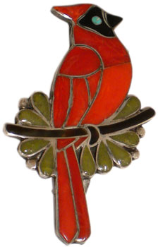 This coral, turquoise, jet, and serpentine cardinal pin was made in the late 1960s or early 1970s by the late Zuni artist Porfilio Sheyka.