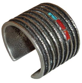 Hopi artist Charles Loloma (1921-1991) is arguably the most famous of all Indian jewelry makers. This cast bracelet has turquoise and coral accents.