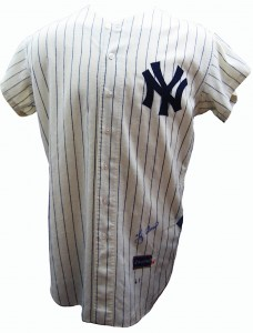 This is a 1961 Yankees uniform signed by catcher Yogi Berra.
