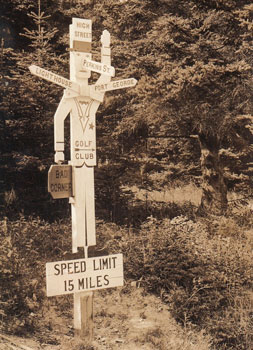 A real photo postcard of a folk art street sign, circa 1920.