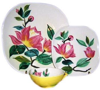 Charles Murphy was the designer of these plates and cup in the Blossom Time pattern, which was produced from 1950 to 1955 and featured a Concord shape.