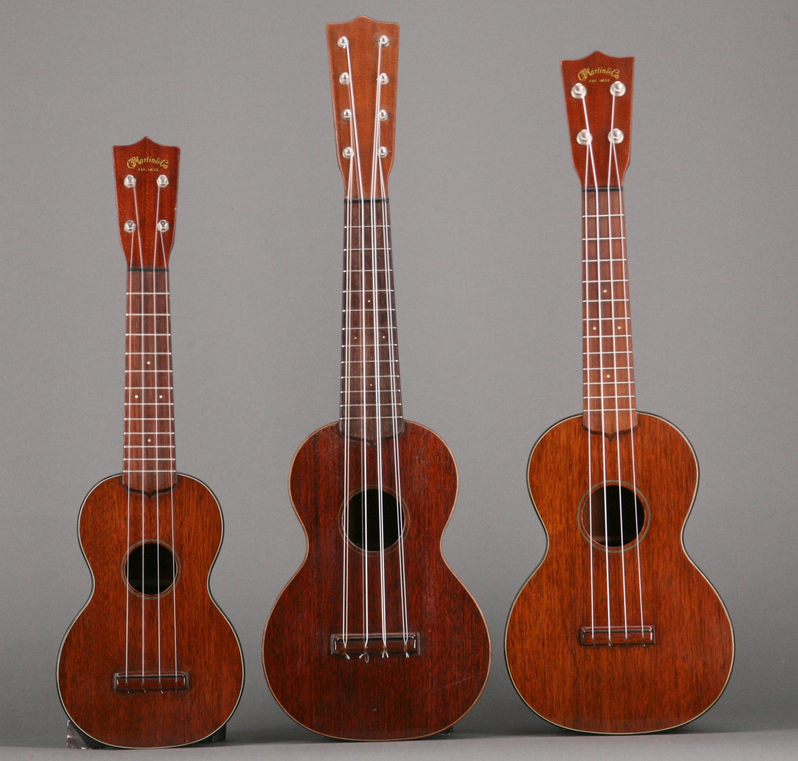 Shown here are three Martin mahogany ukes: On the left is a Style 1 soprano from the late 1940s; in the middle is a Style 1 taropatch from the mid-1920s; and on the right is Martin's concert model, also from the late '40s.