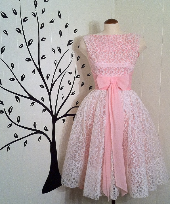Vintage pink dress with lace and bow, available at Some Like It Vintage