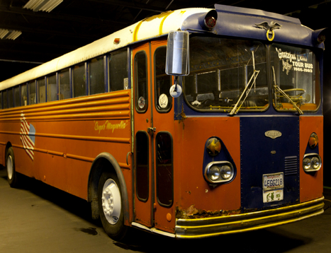 """The """"Tour Rat"""" bus is filled with posters and memorabilia, but the engine does not work."""