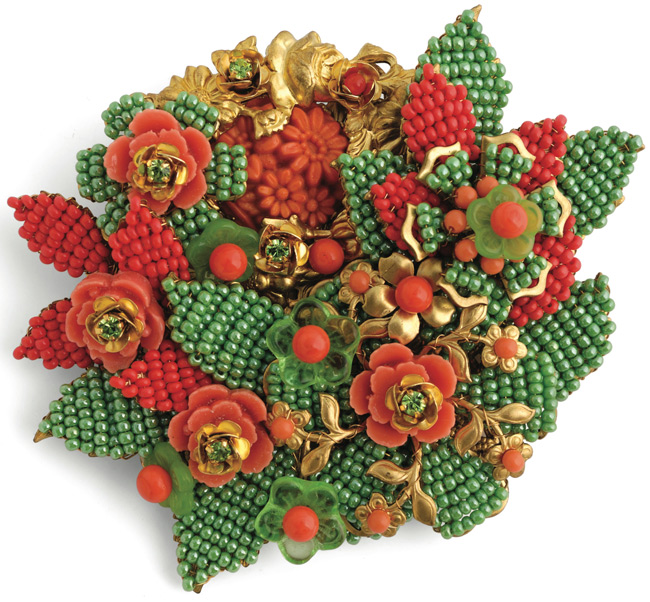An over-the-top 1960s brooch by Stanley Hagler, probably custom-made to match a dress. Miller says it's a good idea, when wearing a heavy piece of Hagler like this one, to pin in through your bra.