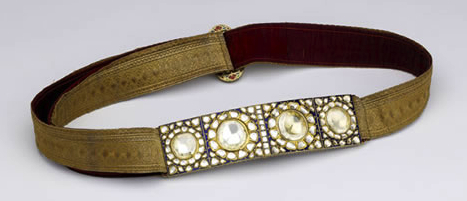 Four enormous diamonds anchor this silk brocade belt, from 1850 to 1900.