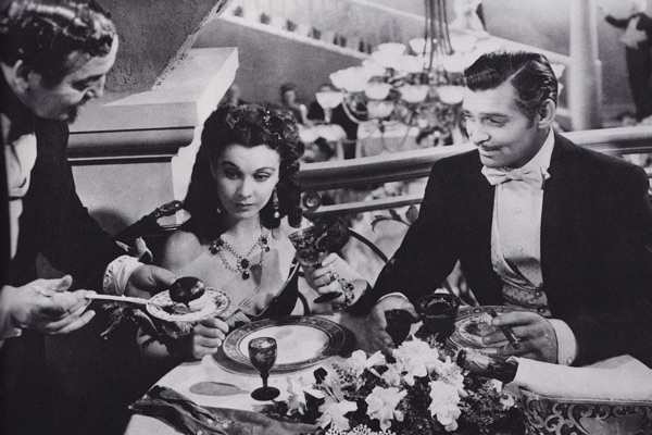 "Vivian Leigh wears Joseff earrings and necklace in a dinner scene with Clark Gable in 1939's ""Gone With the Wind."""