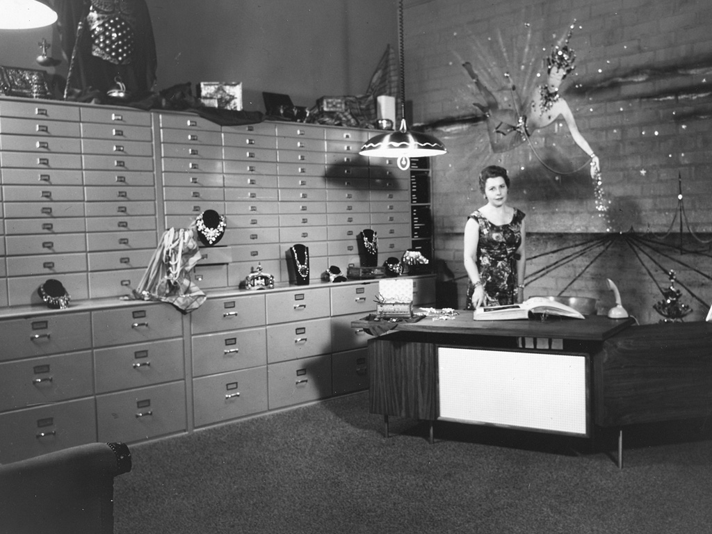 Joan shown at her desk at the Joseff of Hollywood studio in 1953.