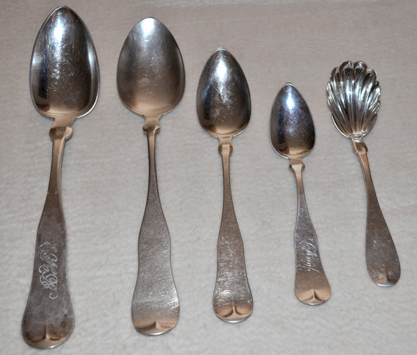 The shoulders of these spoons are rounded, which dates them after the 1820s.