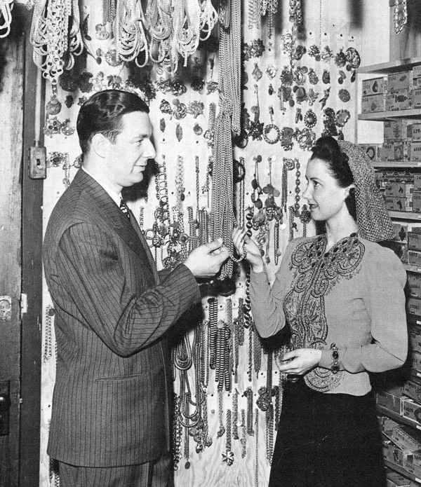 Joseff and actress Katherine Wilson look over his supply of chains. Joseff always kept plenty of chains on hand to meet emergency studio orders. The cigar boxes behind Wilson are the same ones used today.