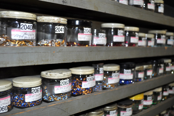 Rows of Swarovski rhinestones (Joseff uses no other) adorn the walls of the tiny Joseff workshop.