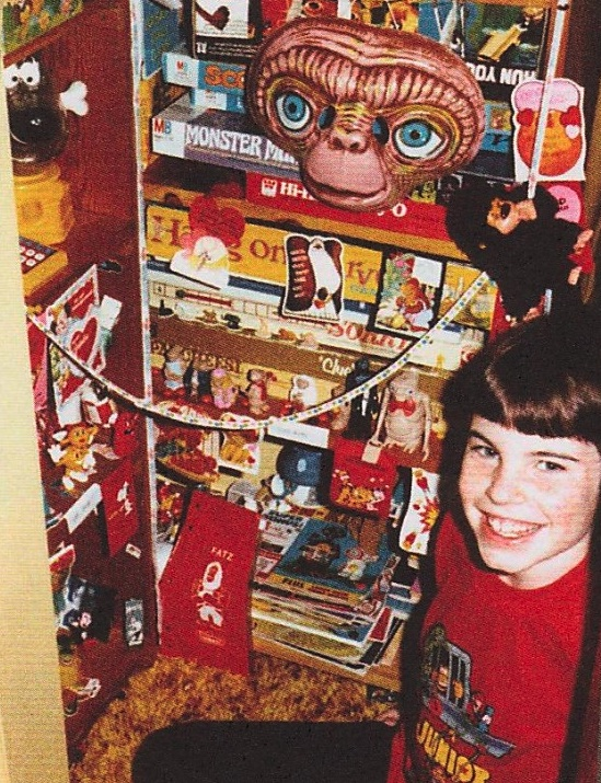 "The author, Kirk Demarais, in the fourth grade, displaying his toy collection. Image via ""Mail-Order Mysteries."""