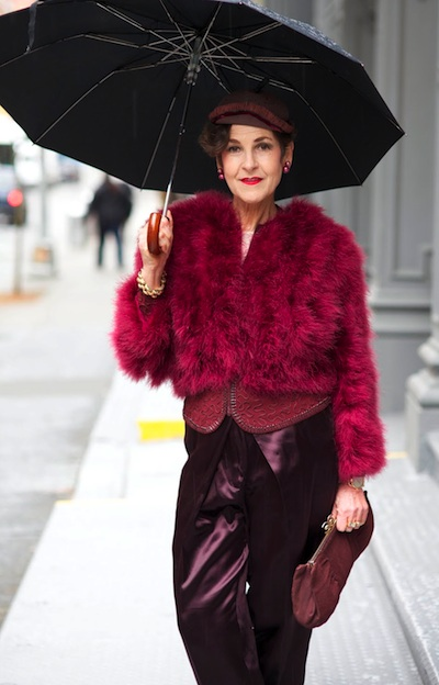 At top, Tziporah Salmon pairs a red antique Catholic priest's chasuble with a red vintage hat from Tibet. Above, she heads to a meeting in a 1930s jacket under an ostrich-feather coat with Haider Ackerman pants. Photo by Ari Seth Cohen, from Advanced Style.