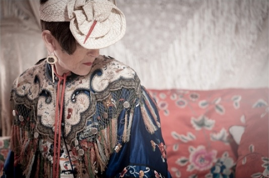 Salamon wears a tasseled cloud collar from the Qing Dynasty over a 1930s Chinese coat with a 1920s straw hat and earrings made of antique ivory Chinese game pieces. Photo by Martin Scott Powell, martinscottpowell.com