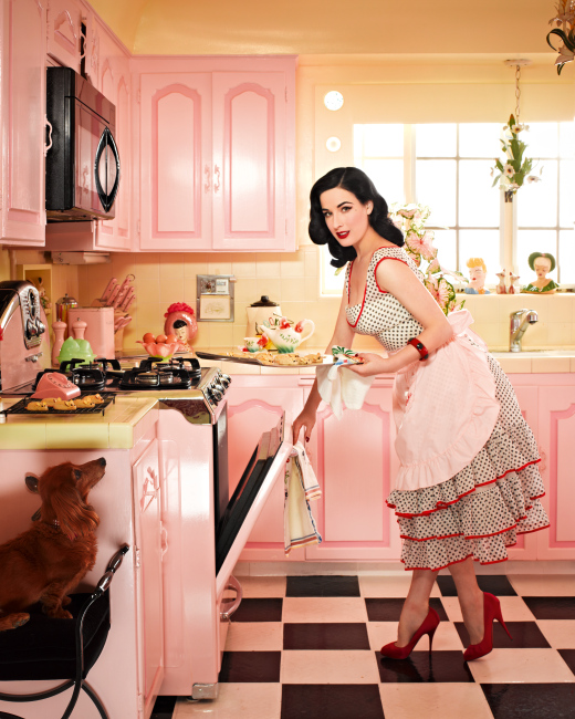 In her kitchen lined with head vases, Von Teese serves cookies and tea in a vintage teapot. Photo by Douglas Friedman.