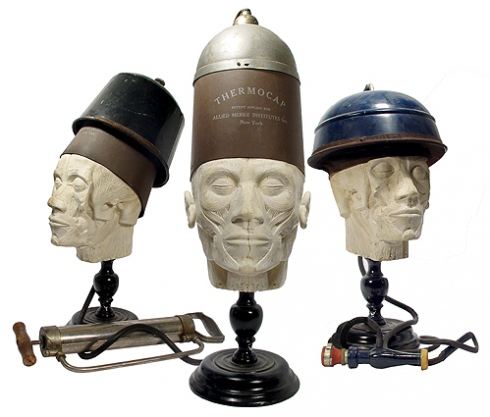 Several early mechanical devices intended to cure balding. Via Radio-Guy.com.