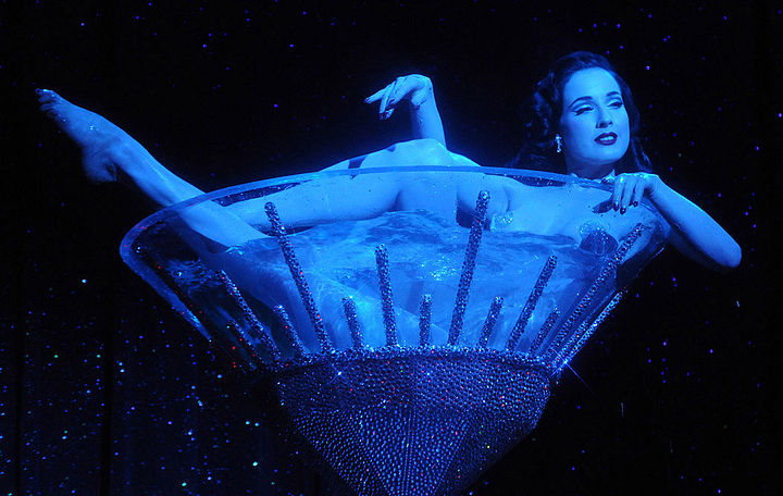 "Von Teese takes a champagne bath in her ""Burlesque: Strip Strip Hooray!"" tour stop in Las Vegas. Photo by Scott Harrison, via Dita.net."