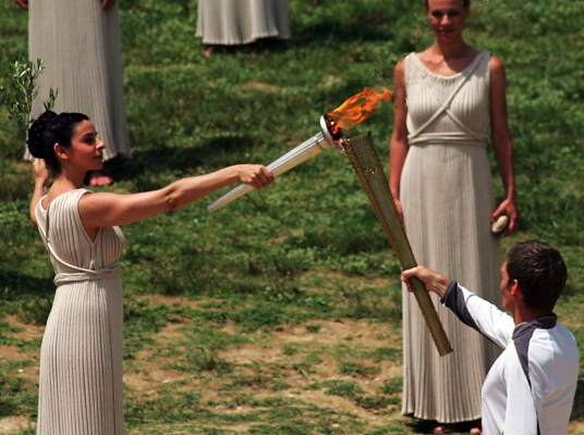 British-born Greek swimmer Spyros Gianniotis received the flame for the 2012 London Games from the high priestess in Olympia, Greece, on May 10. Via InsidetheGames.biz.