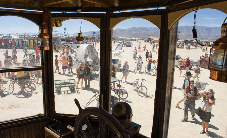 Looking out the windshield of the Neverwas Haul onto the playa at Burning Man. Photo by Andy Pischalnikoff.
