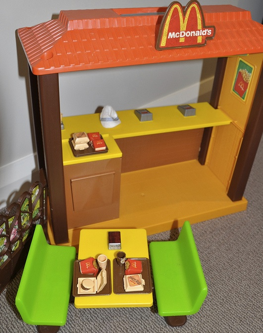 It's the same cow, ground up and served in little boxes: A 1982 Barbie McDonald's playset.