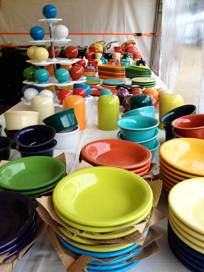 A booth dedicated to Fiesta dinnerware at the Brimfield Antiques Fair in May. Photo by Joanna Mangan.