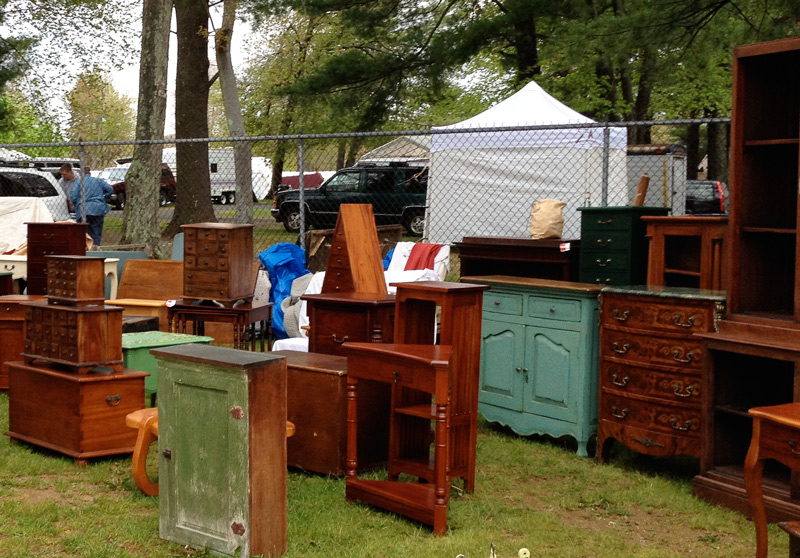 You can get solid-wood antique furniture at Brimfield for a lower price than a particle-board piece from IKEA. Photo by Ben Marks.
