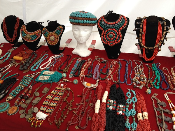 Turquoise and coral jewelry at a Brimfield booth. Photo by Ben Marks.