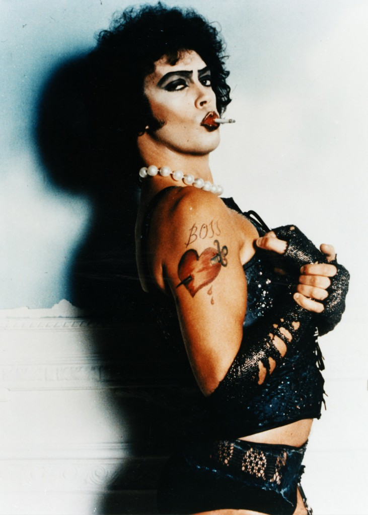 "Costumes for ""The Rocky Horror Picture Show"" featured a blend of punk, glam, and drag camp, seen here on original cast member Tim Curry. Photo by Mick Rock."
