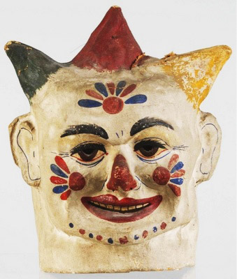 Try this baby on for size: a vintage papier-mache clown mask guaranteed to keep suitors at bay.