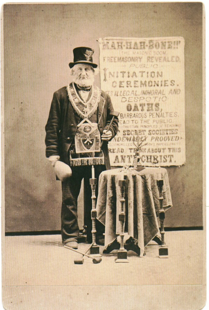"This anti-Masonic protestor from 1870 has a sign decrying ""illegal, immoral, and despotic oaths."" Via Phoenixmasonry.org."