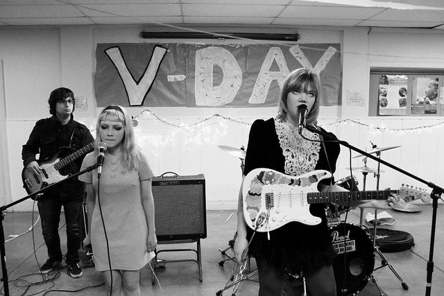 Tavi (middle) performs with friends for V-Day, an activist event to end violence against women.