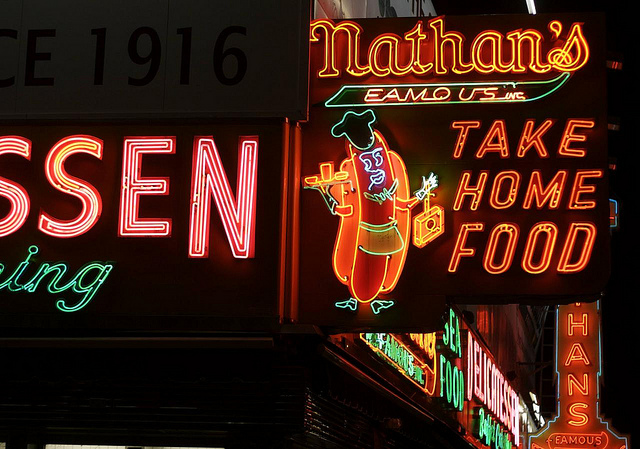 Nathan's Famous Hot Dogs chain has a particularly elaborate neon sign on the corner of Surf and Stillwell in Coney Island. Photo by Hively.