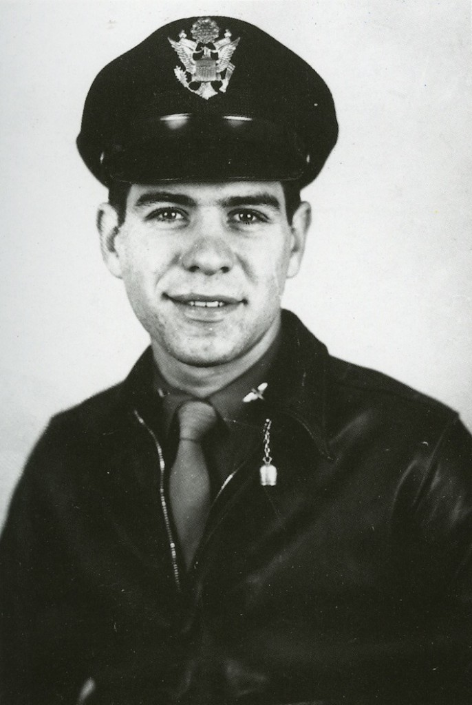 "Capt. Sam Trave, of the 347th Fighter Group, wears a silver ""Good Luck"" bell from San Michele, Isle of Capri, attached to the collar hook on his unusually dark A-2 jacket."