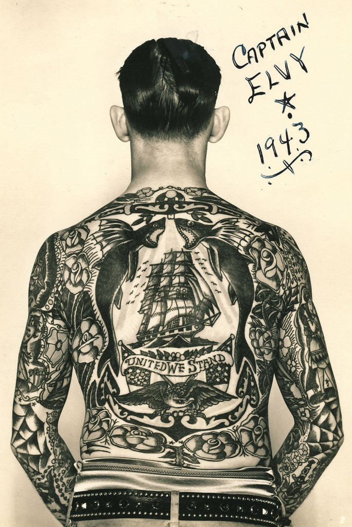 "Captain Elvy, who worked as a sideshow attraction, displays his beautiful back piece designed by ""Sailor"" George Fosdick."