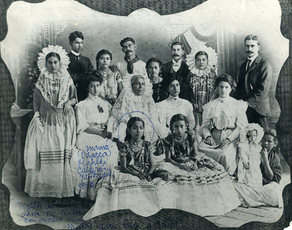 This portrait from 1890 shows Kahlo's maternal family wearing Tehuana style clothing. Frida's mother, Matilde Calderón, is circled at center. Courtesy Museo Frida Kahlo.