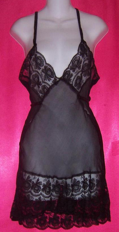 This vintage black silk slip has a full-lace bust, an under-bust tie, and eight inches of lace at the hem. Via aslipofagirl.net.