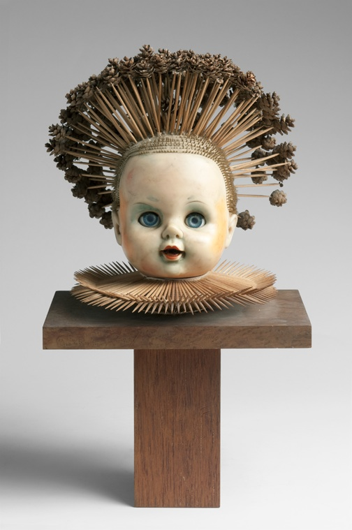 "Harper took the head from one of his daughter's discarded dolls and added toothpicks and pine cones. Photo by D. James Dee, from ""Irving Harper Works in Paper."""