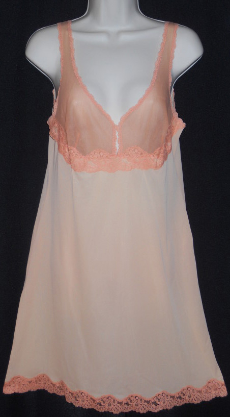 A vintage two-tone peach slip, made of nylon, with a keyhole cutout in the chiffon bodice. Via aslipofagirl.net.