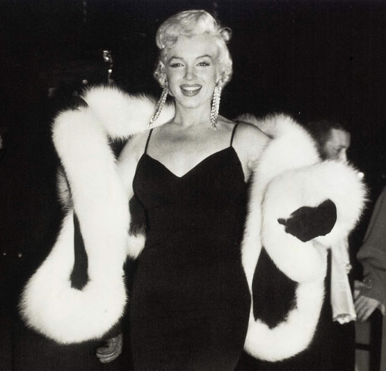 A black silk jersey stole trimmed with white fox fur sold for $49,946, along with this photo of Marilyn wearing the stole, at a December 2008 auction in London. (Christie's Images Ltd.)